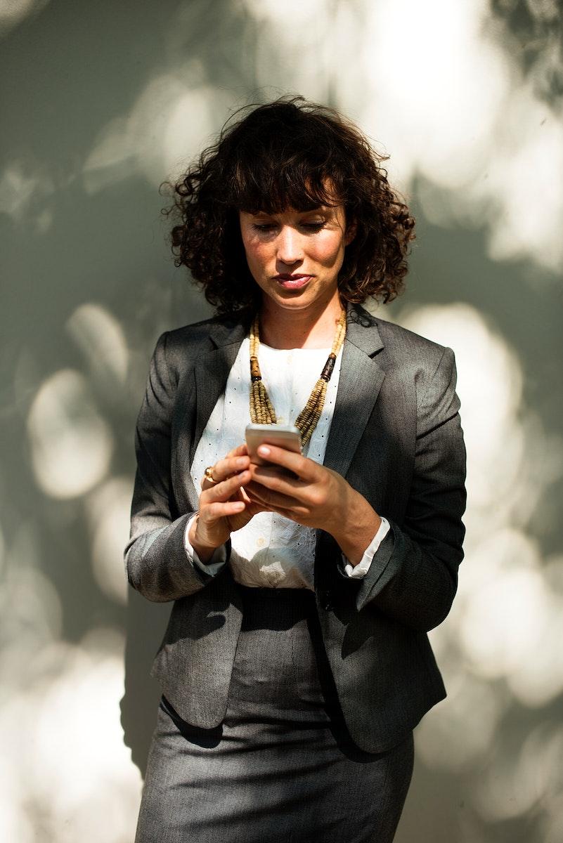 Businesswoman using mobile phone communication technology