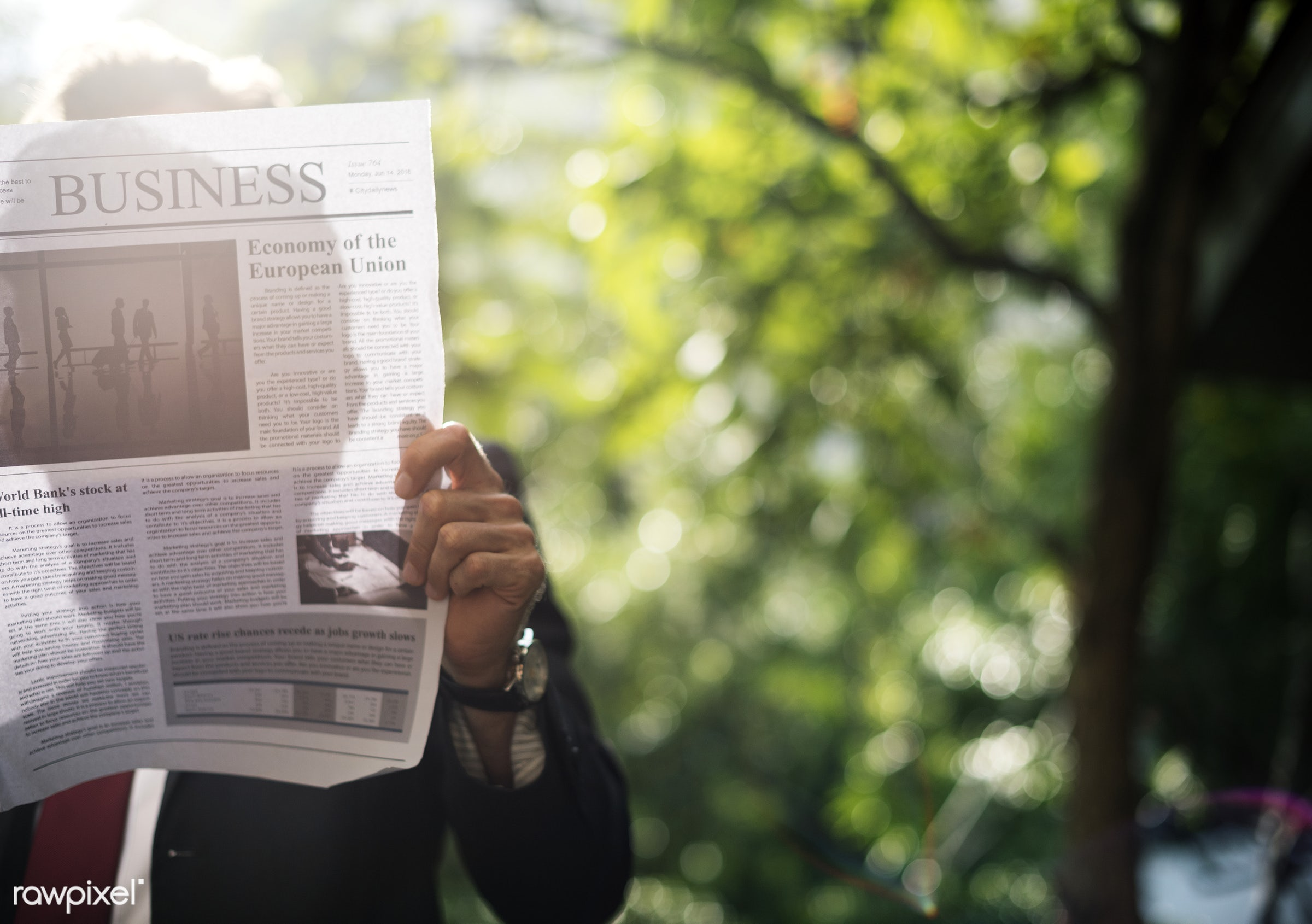 Businessman standing and reading newspaper - business, finance, newspaper, sunlight, cc0, corporate, creative common 0,...