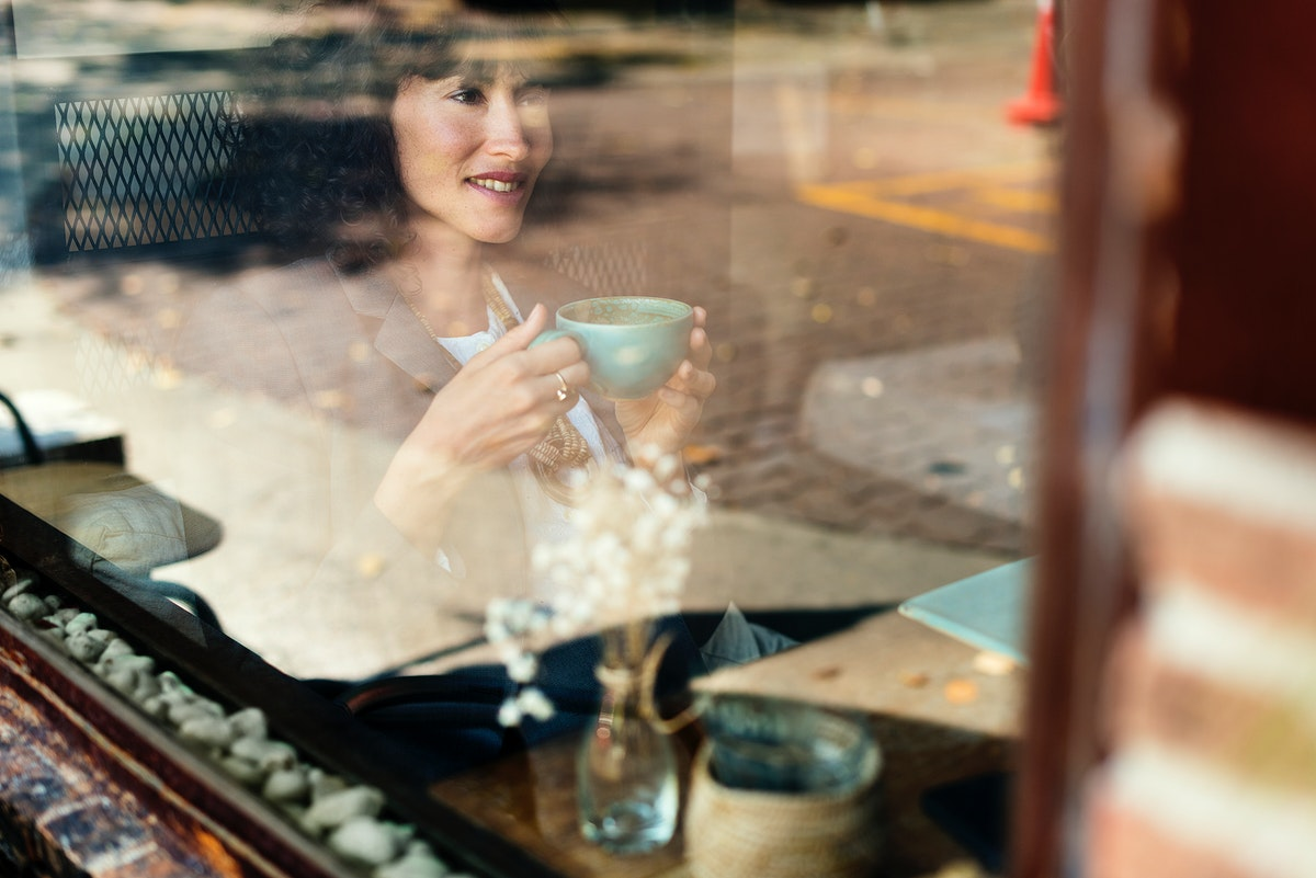 Woman chilling out with coffee at cafe
