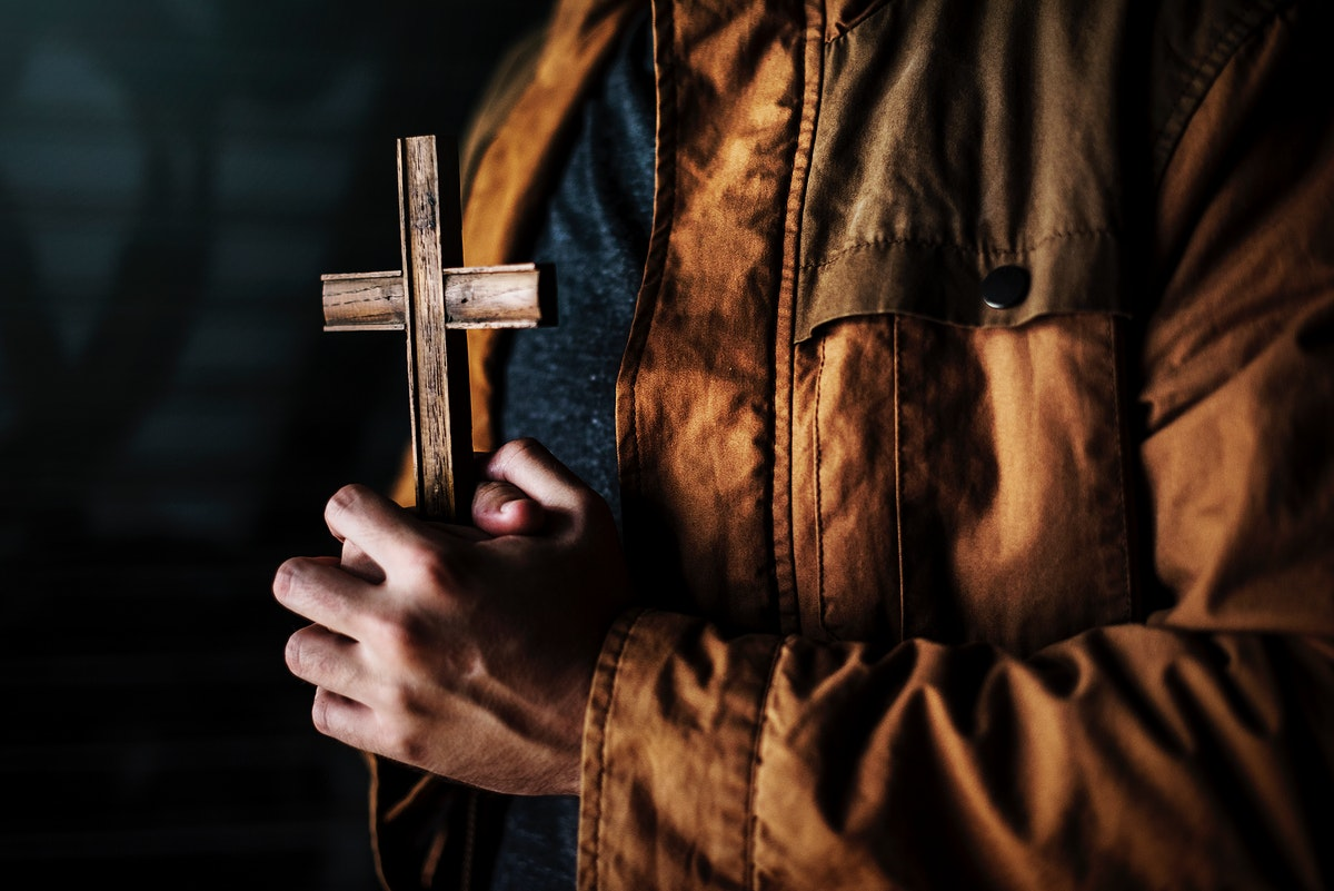 Hands Holding Cross Praying for God Religion