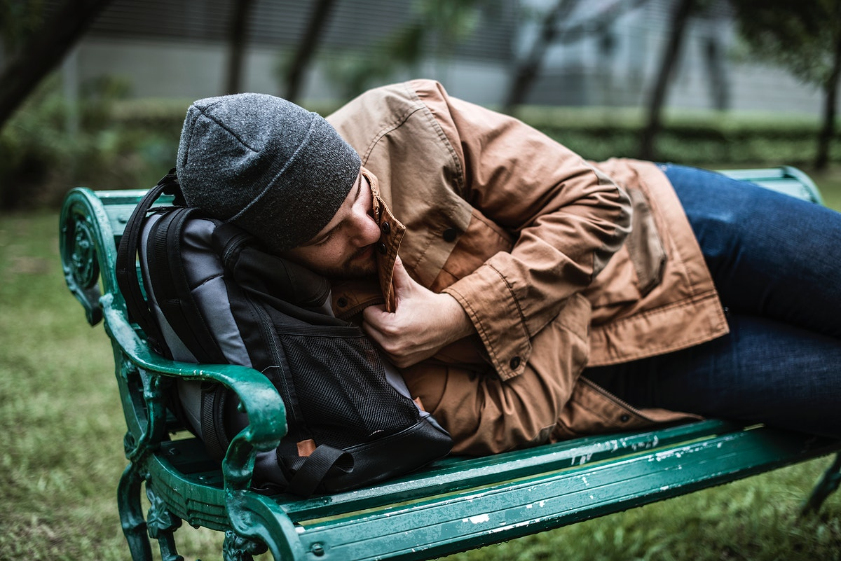 Homeless People Sleeping on Bench in The Park