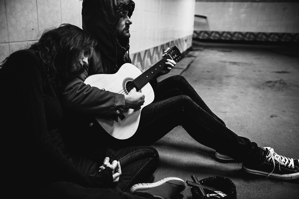Homeless Couple  Playing Guitar Asking For Money Donation