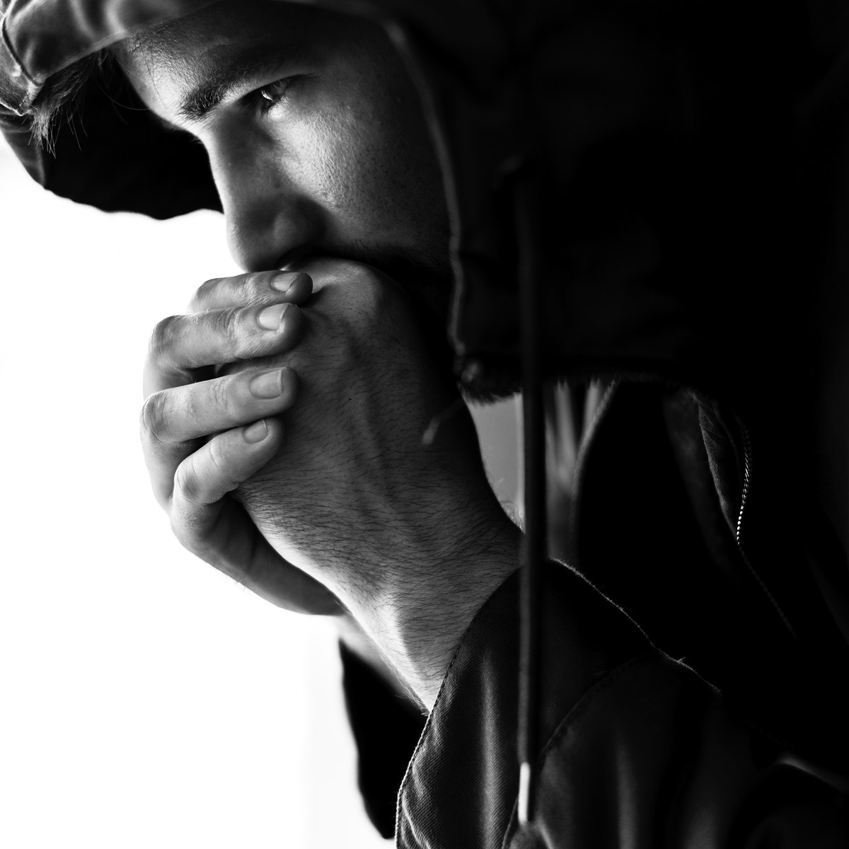 Closeup of homeless sitting thoughtful