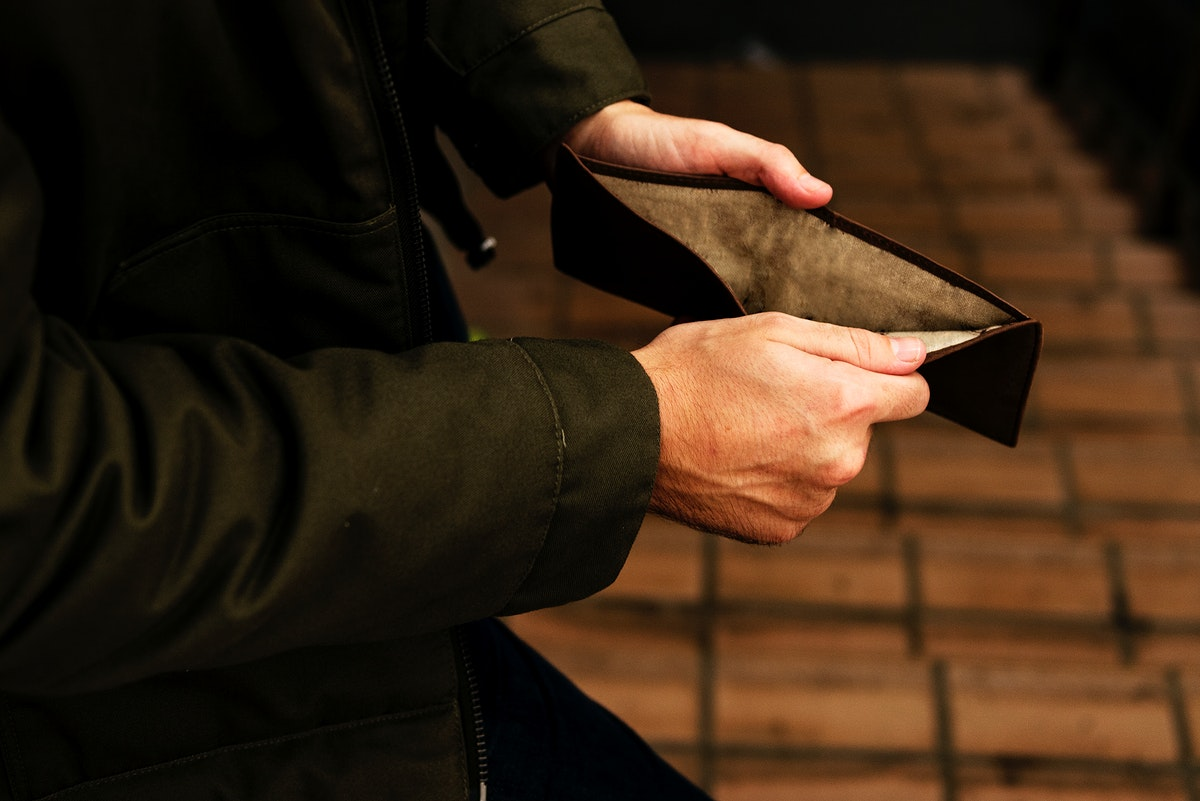 Hands open checking at the wallet