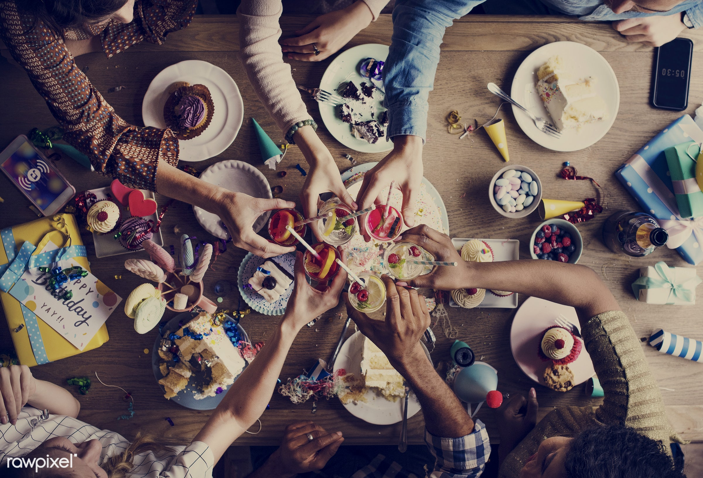 Aerial view of friends doing a toast at the table - birthday, festive, person, occasion, party, people, together, hands,...