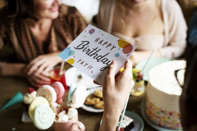 Hand Holding Birthday Wishing Card
