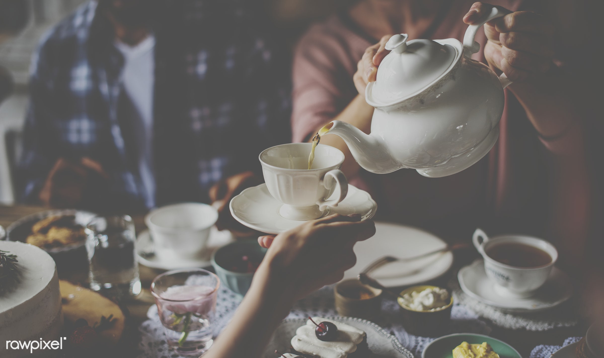 Pouring some tea in a cup - cake, dessert, drink, eat, event, gather, hands, happiness, man, men, occasion, party, people,...