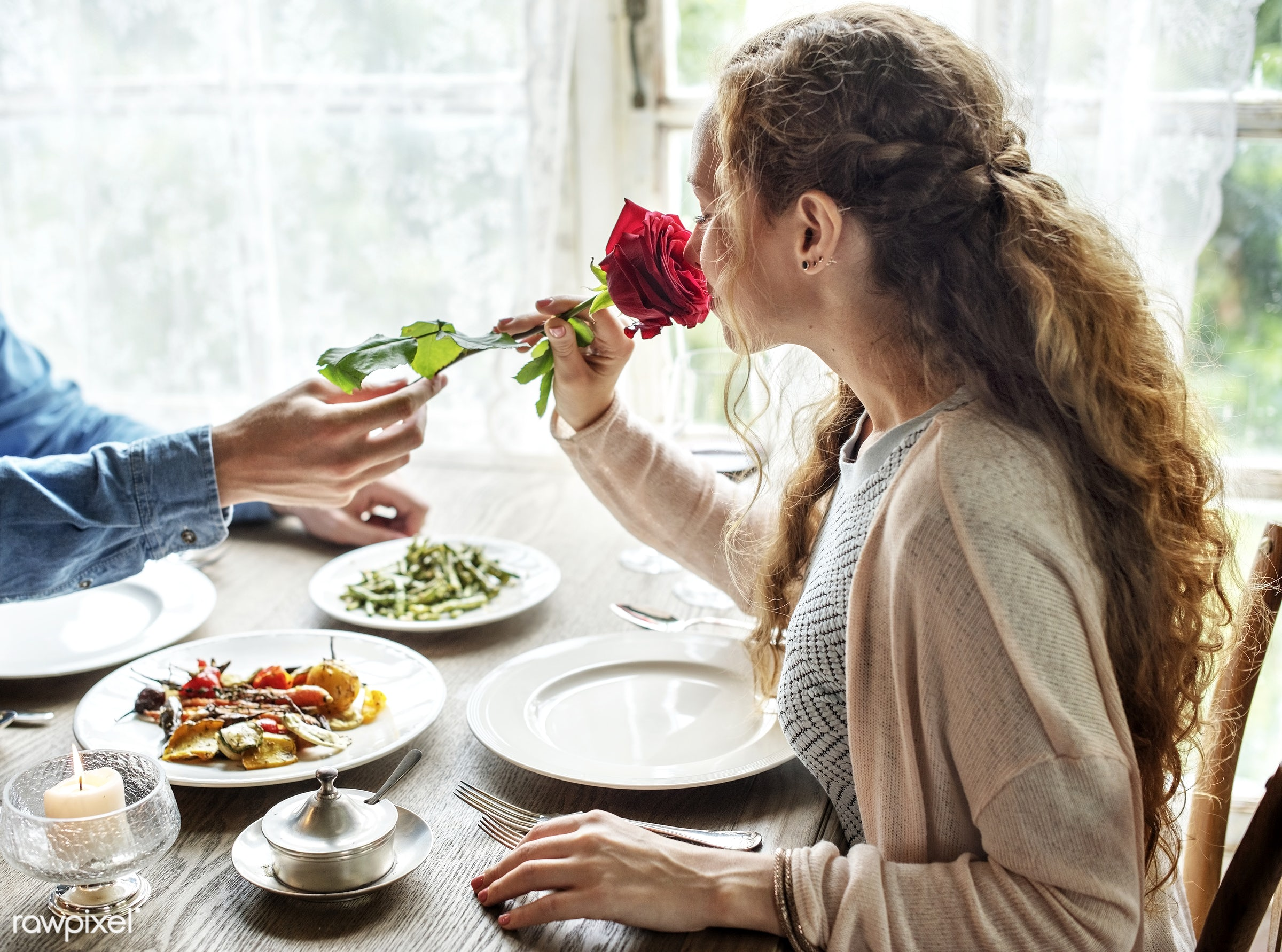 Romantic Man Giving a Rose to Woman on a Date - valentine, giving, rose, adult, celebrate, celebration, cheerful, couple,...