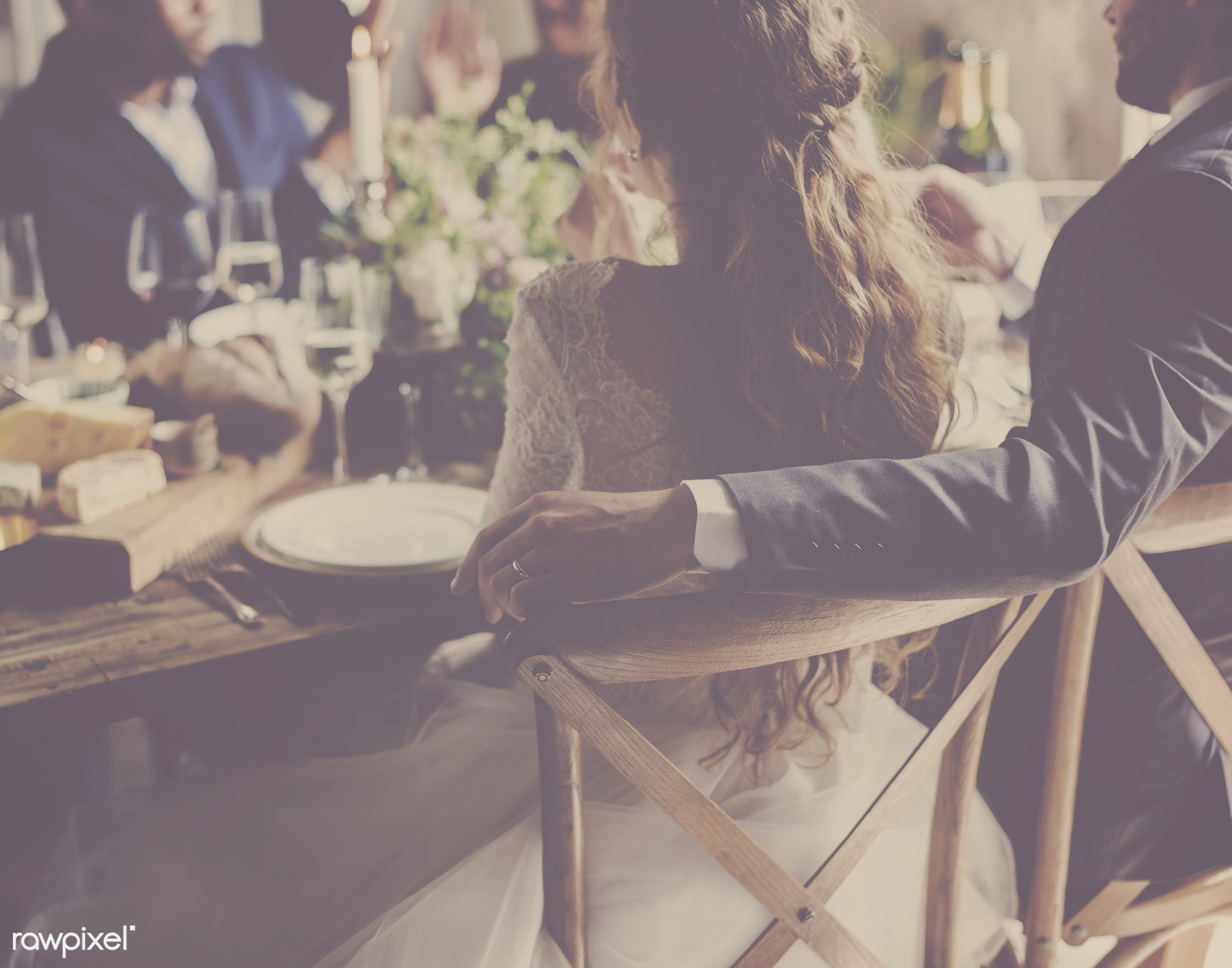 Bride in groom sitting at their reception table - bride, celebrate, celebration, ceremony, couple, event, gather, groom,...