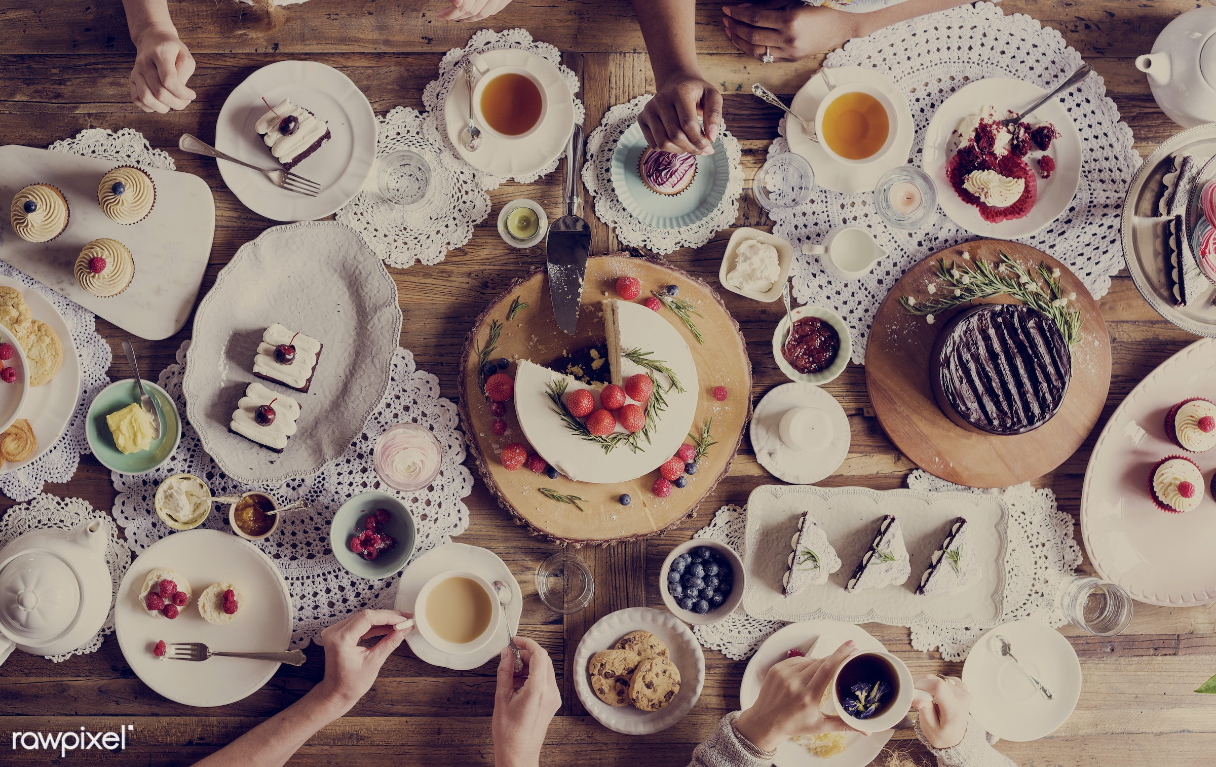 Aerial view of table filled with desserts - cake, dessert, drink, eat, event, gather, hands, happiness, man, men, occasion,...
