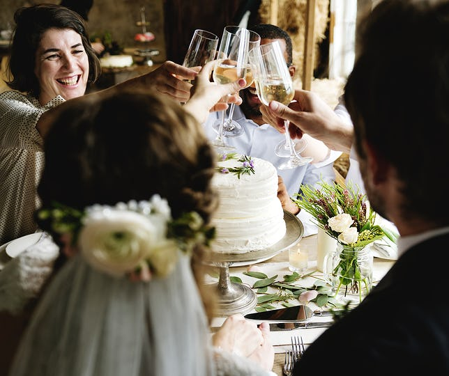 Bride and Groom Toasting with Wine Glasses at a Wedding Reception
