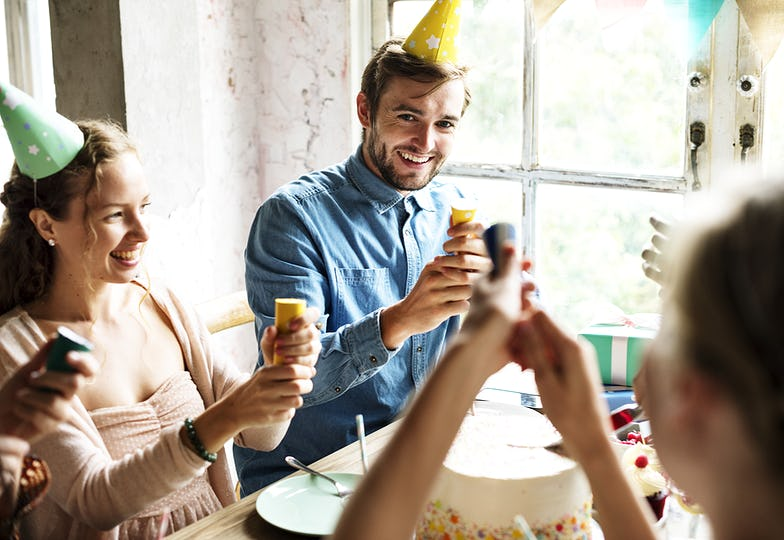 People Using Party Popping on Friend Birthday Celebration