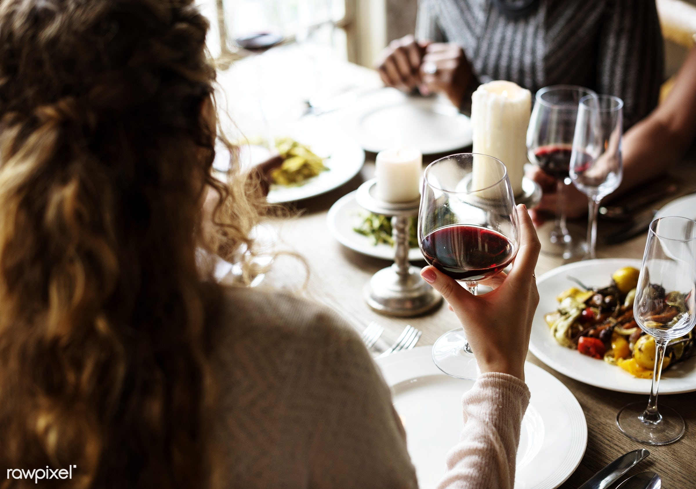 Woman Holding Red Wine Glass in a Classy Restaurant - red wine, tasting, adult, beverage, chardonnay, cheerful, classy,...