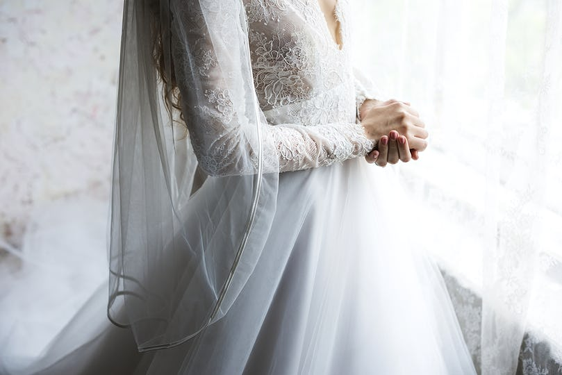 Attractive Beautiful Bride in a Wedding White Dress