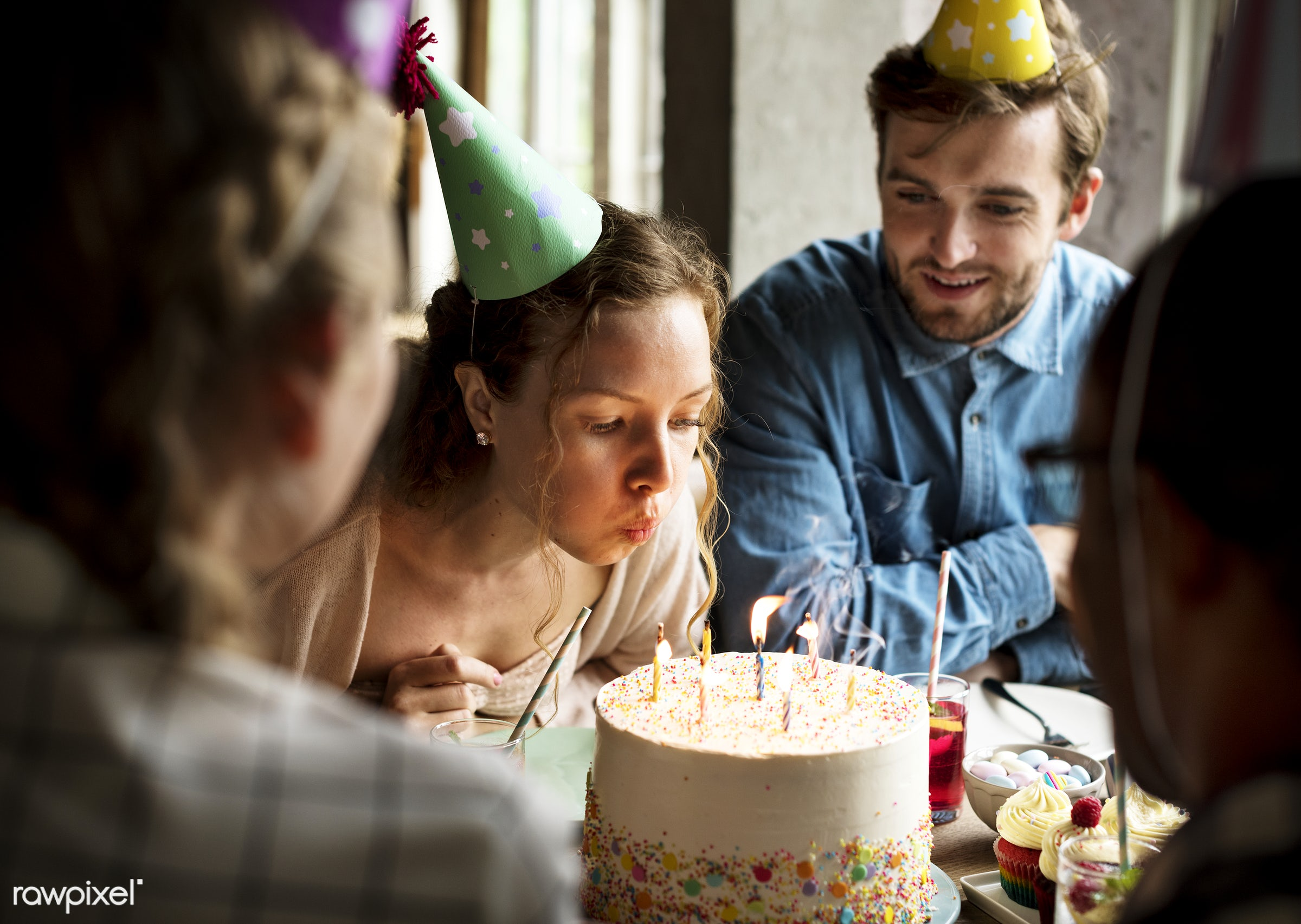Woman Blowing Candles on Cake on Her Birthday Party Celebration - bakery, birthday, blowing, cakes, candles, celebrate,...
