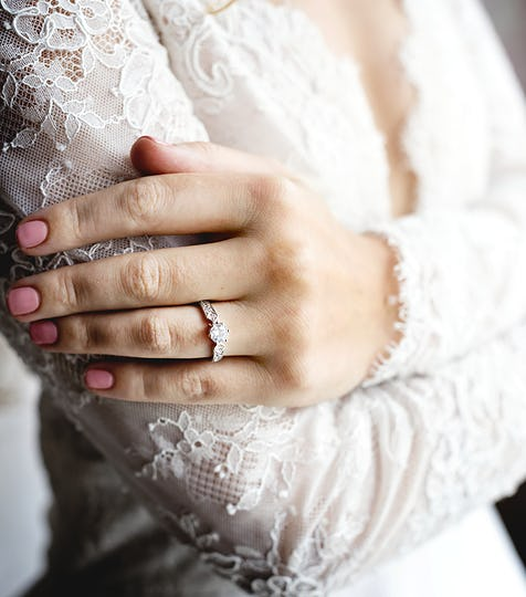 Attractive Beautiful Bride Showing Engagement Wedding Ring on Hand