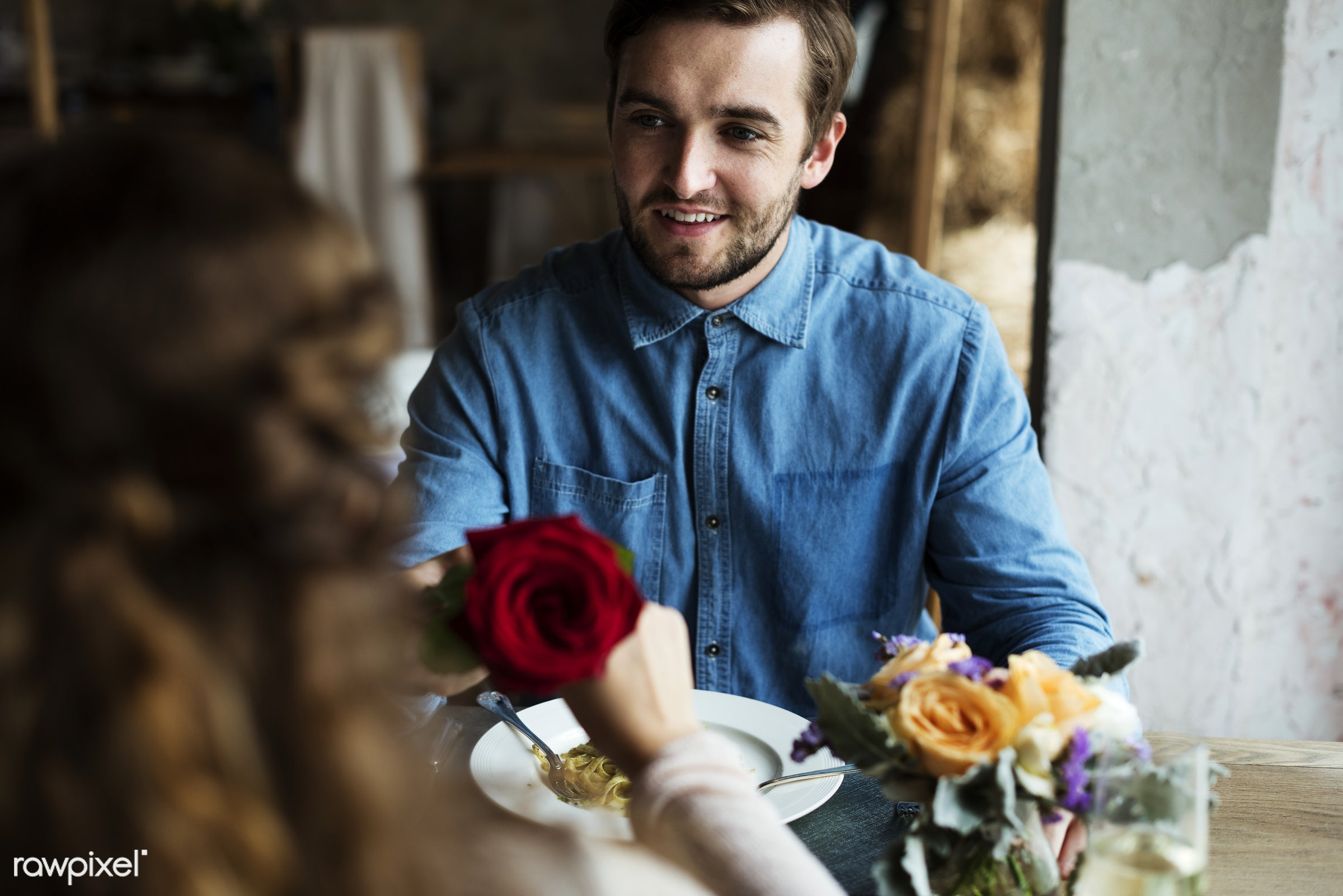Romantic Man Giving a Rose to Woman on a Date - giving, adult, celebrate, celebration, cheerful, couple, date, dating, dine...