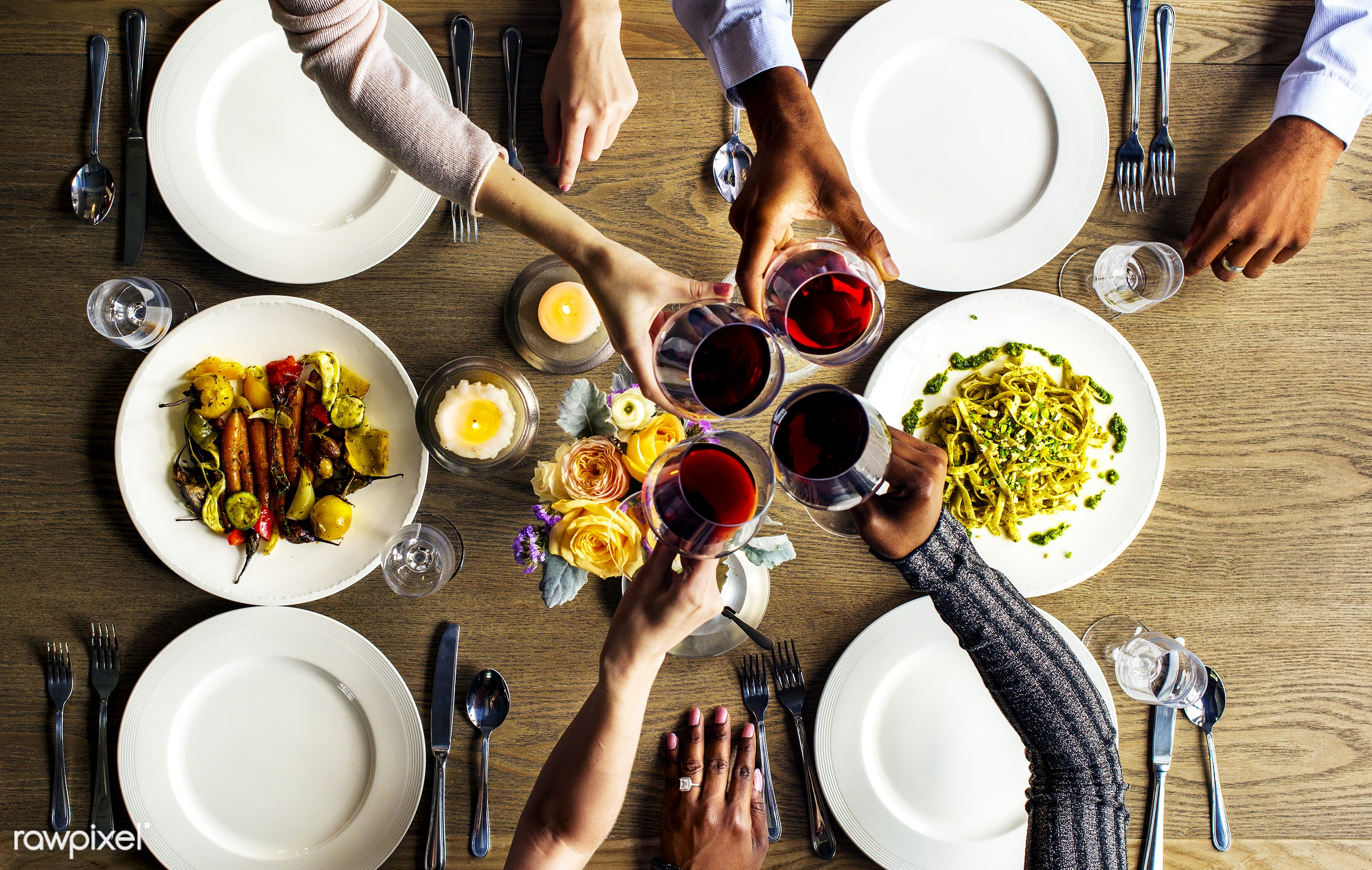 People Clinging Wine Glasses Together in Restaurant - restaurant, eat, adult, african descent, candles, caucasian, celebrate...