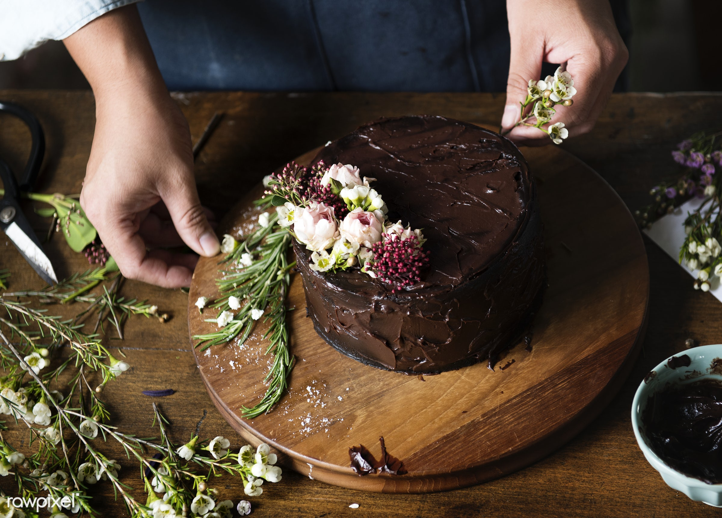 Baker Man Decorating Chocolate Cake with Flowers - decoration, cake, chocolate, bakery, patisserie, sweet, dessert, flowers...