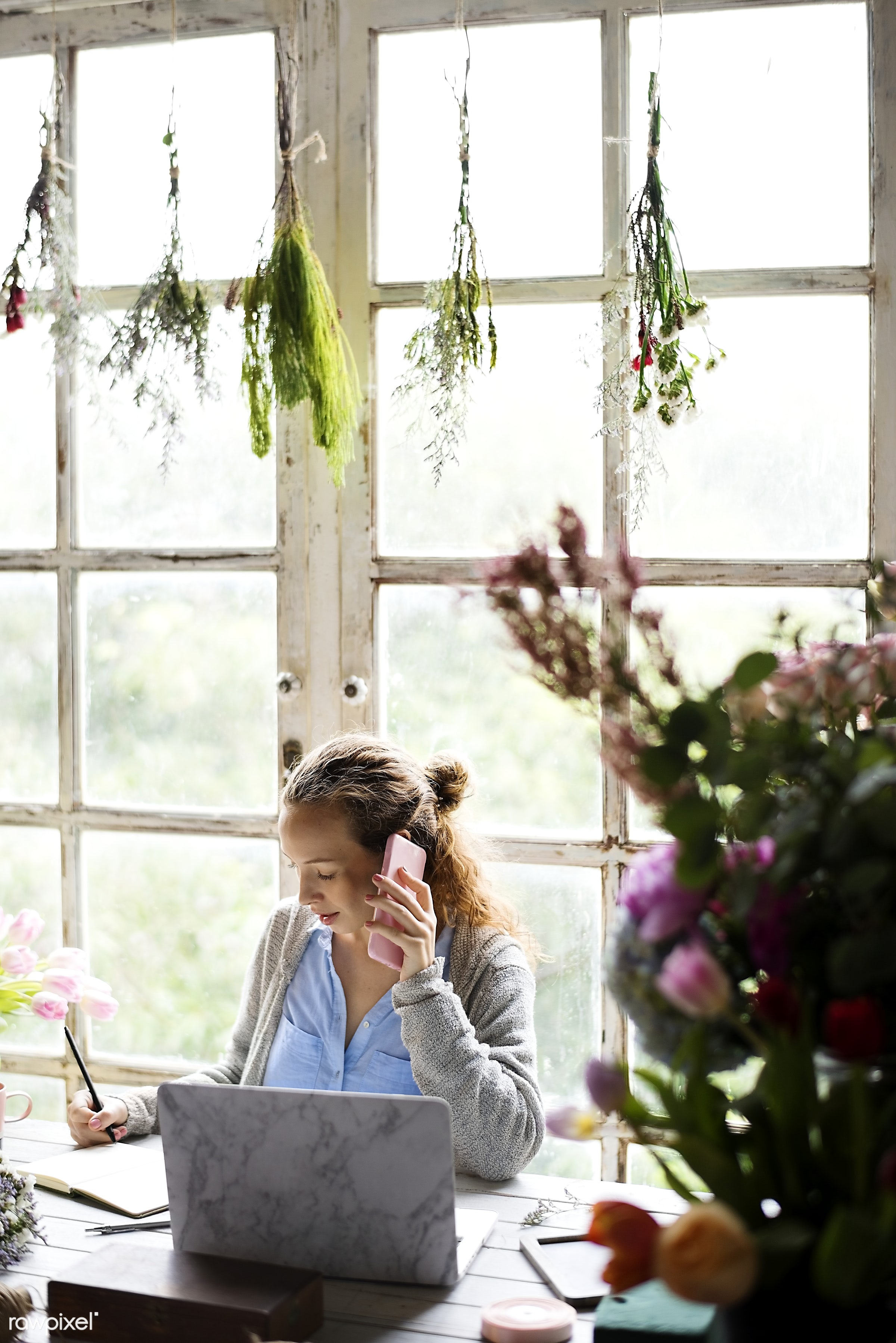 Woman talking on the phone with plants hanging above - hanging, plants, leaves, florist, botany, woman, caucasian, girl,...