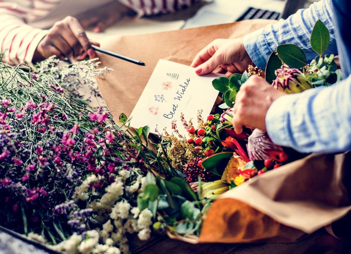 Florist Making Fresh Flowers Bouquet Arrangement with Best Wish