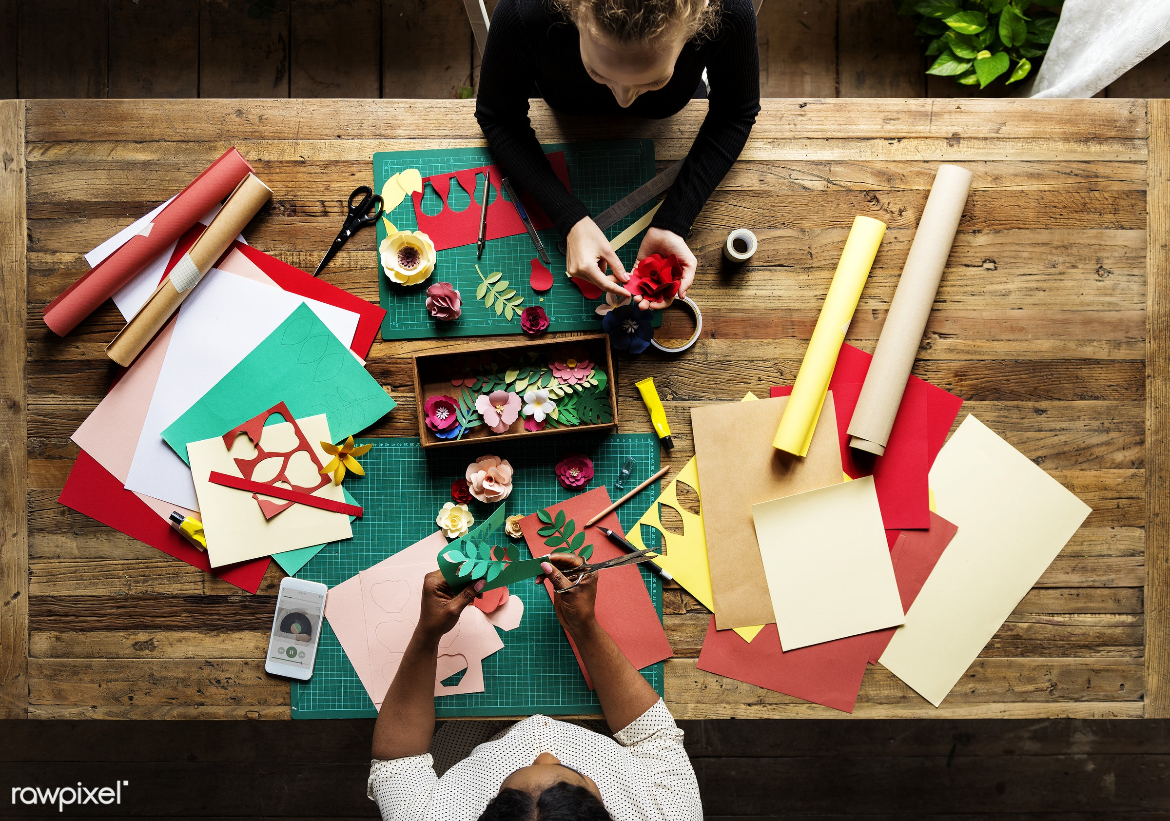 Aerial view of messy paper craft work table - art, design, skill, talent, paper, craft, handmade, stationery, cutout,...