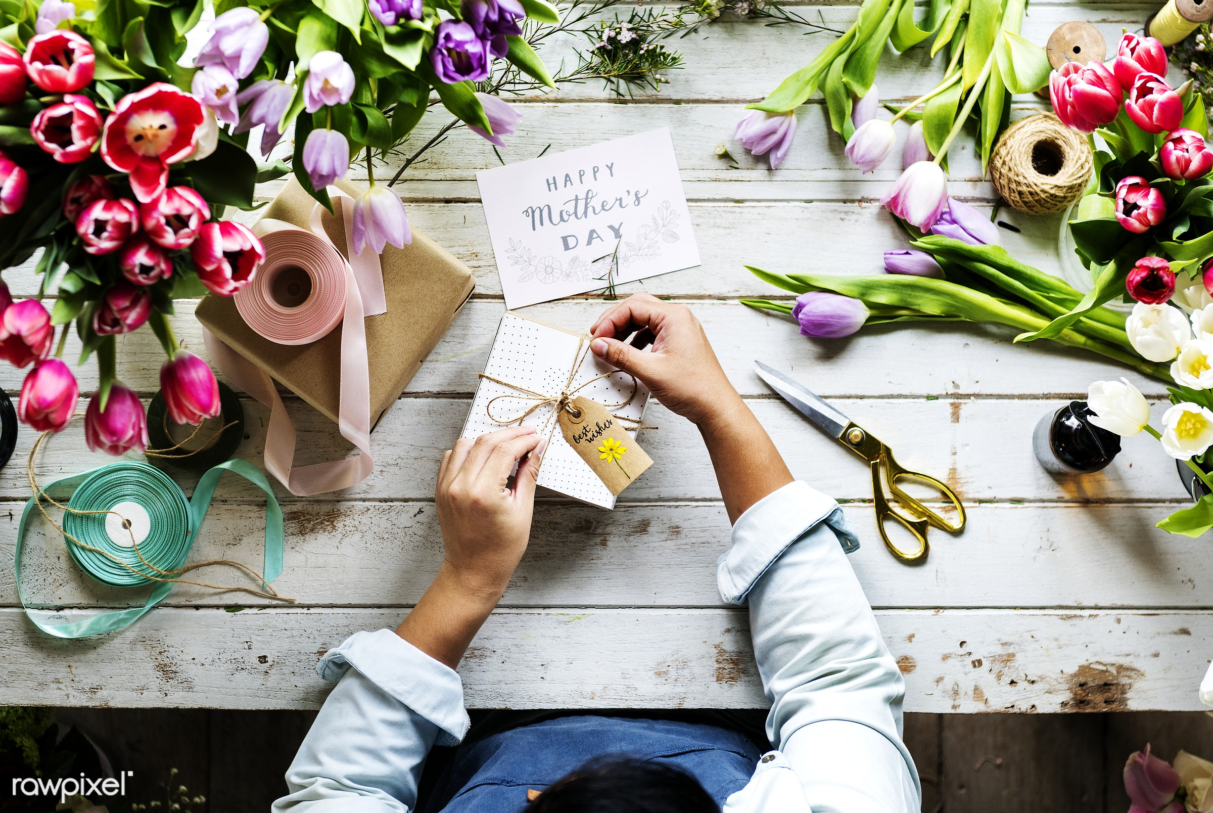 Hands wrapping a present for mother's day - flowers, florist, job, occupation, arrangement, decoration, real, fresh, card,...
