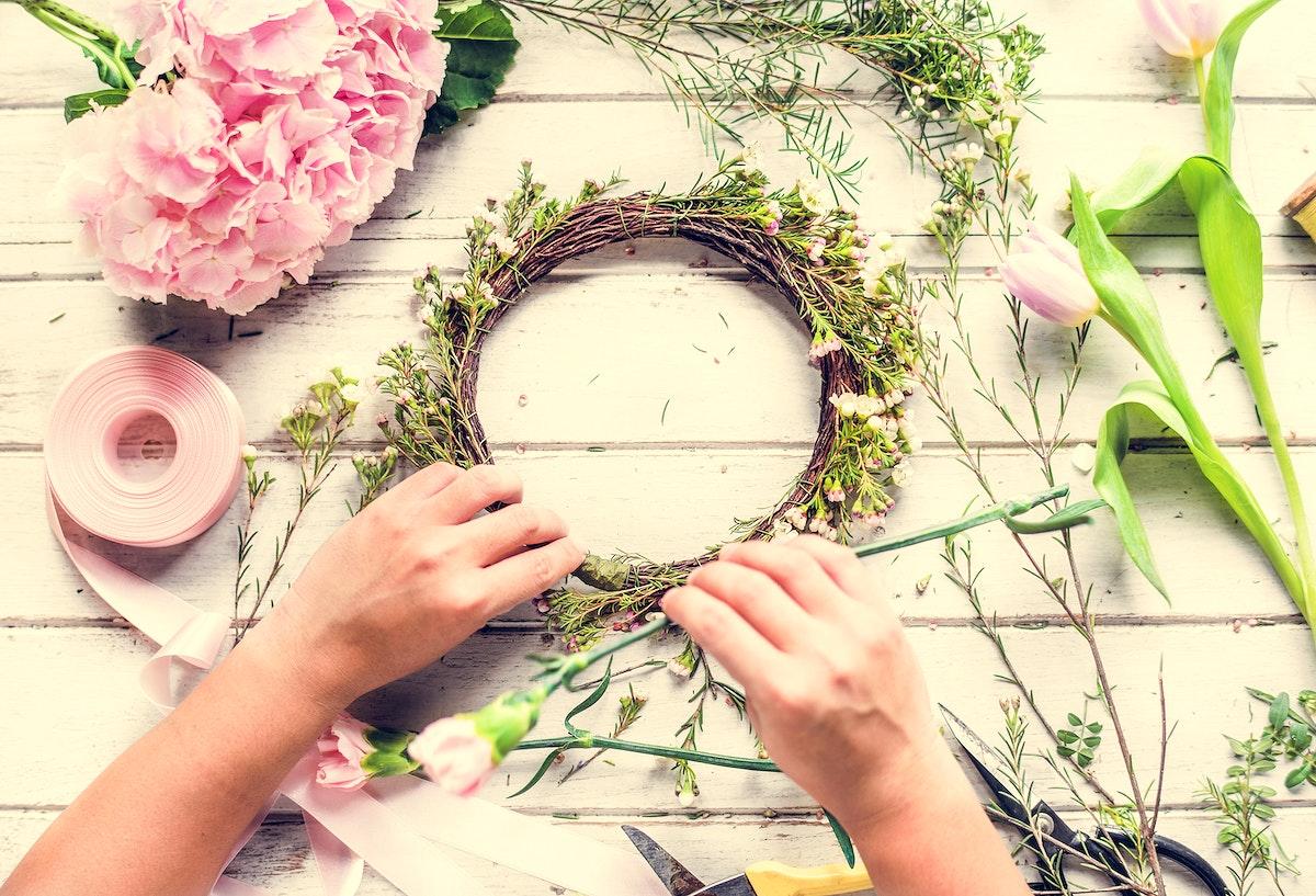 Florist Making Fresh Flowers Crown Arrangement