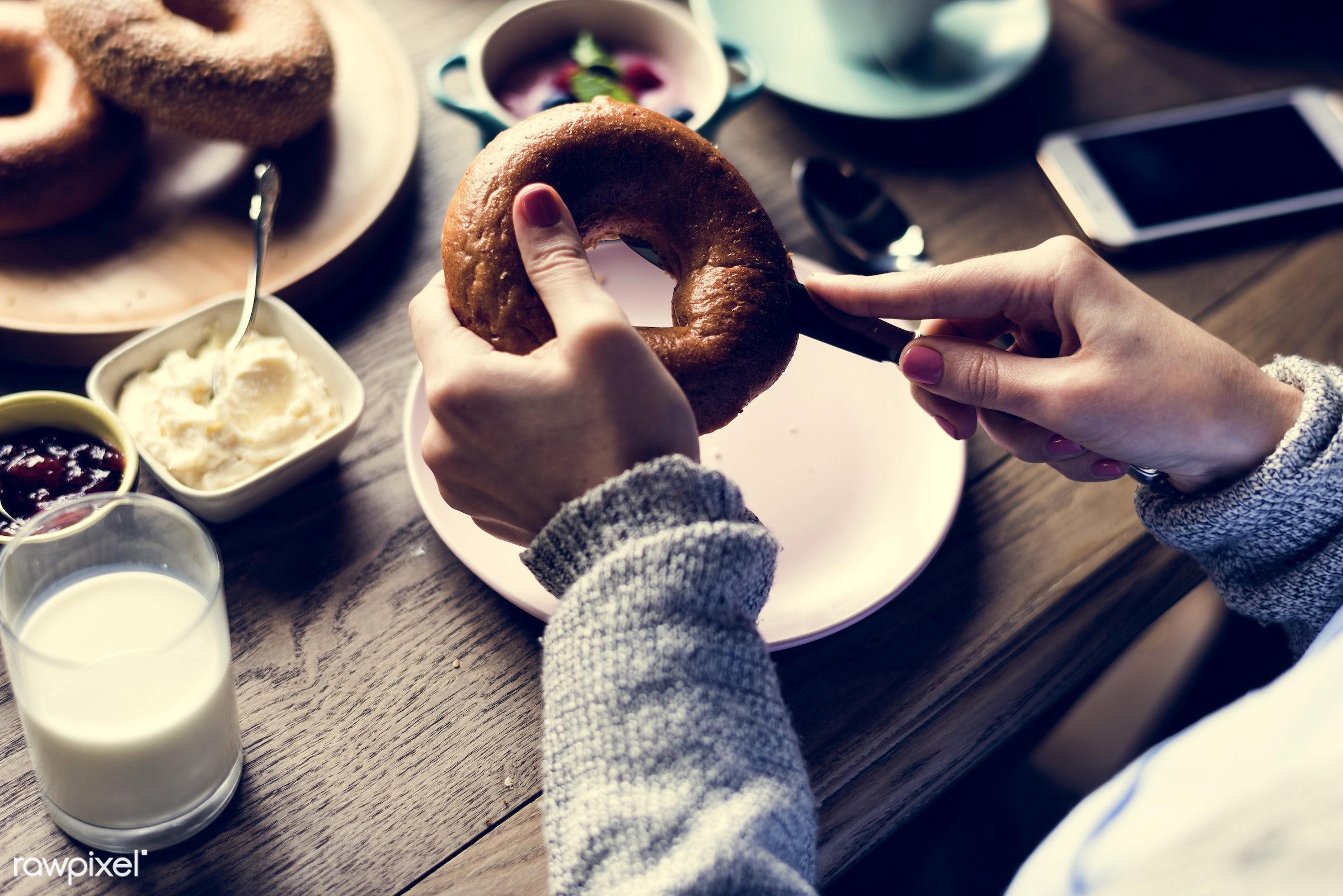 cup, dish, person, yoghurt, holding, breakfast, people, drinks, bakery, hands, woman, milk, bread, mobile phone, jam, knife...
