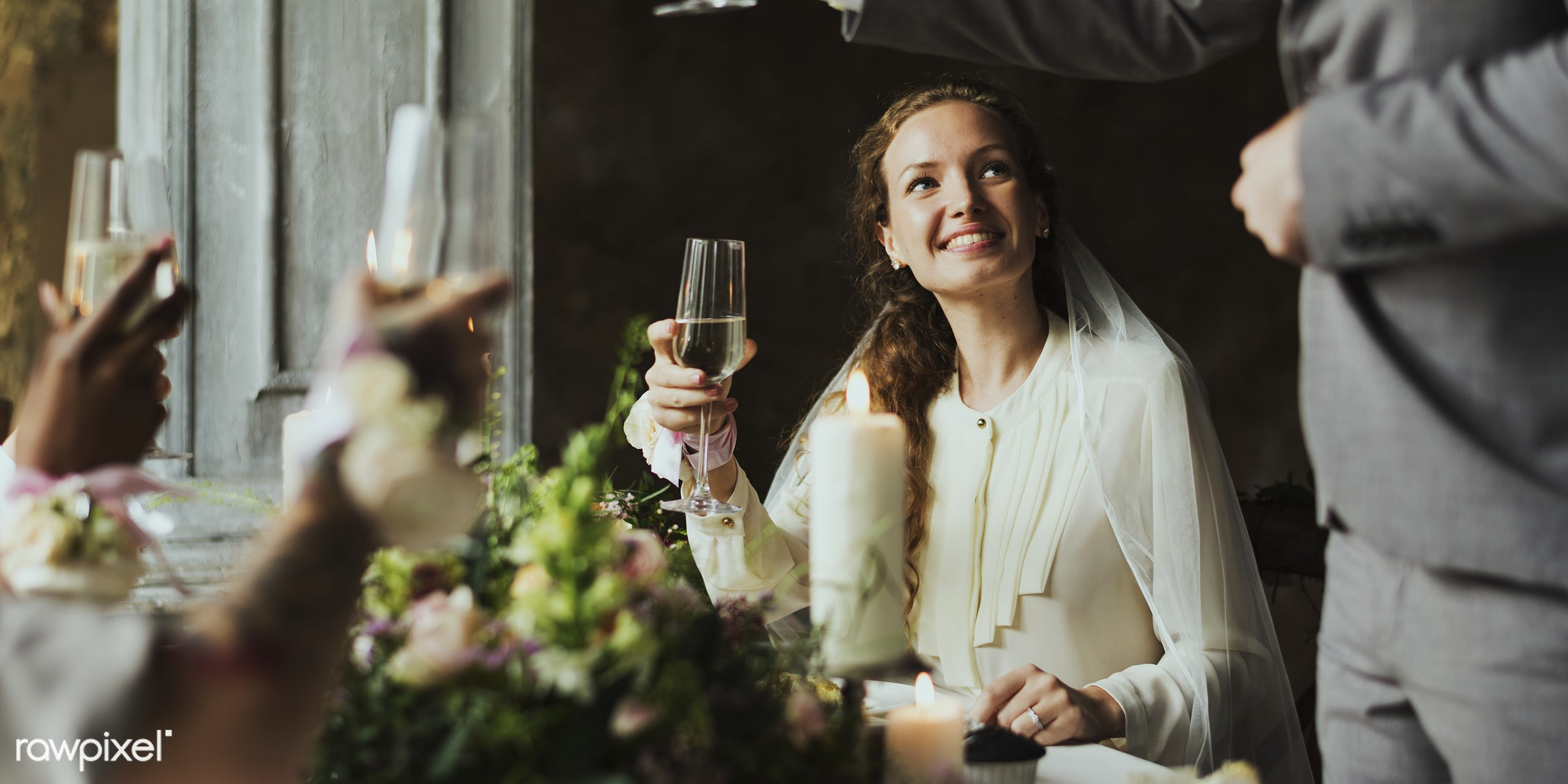 Bride listening to a speech at wedding reception table - alcohol, bride, celebration, champagne, couple, drinking, event,...