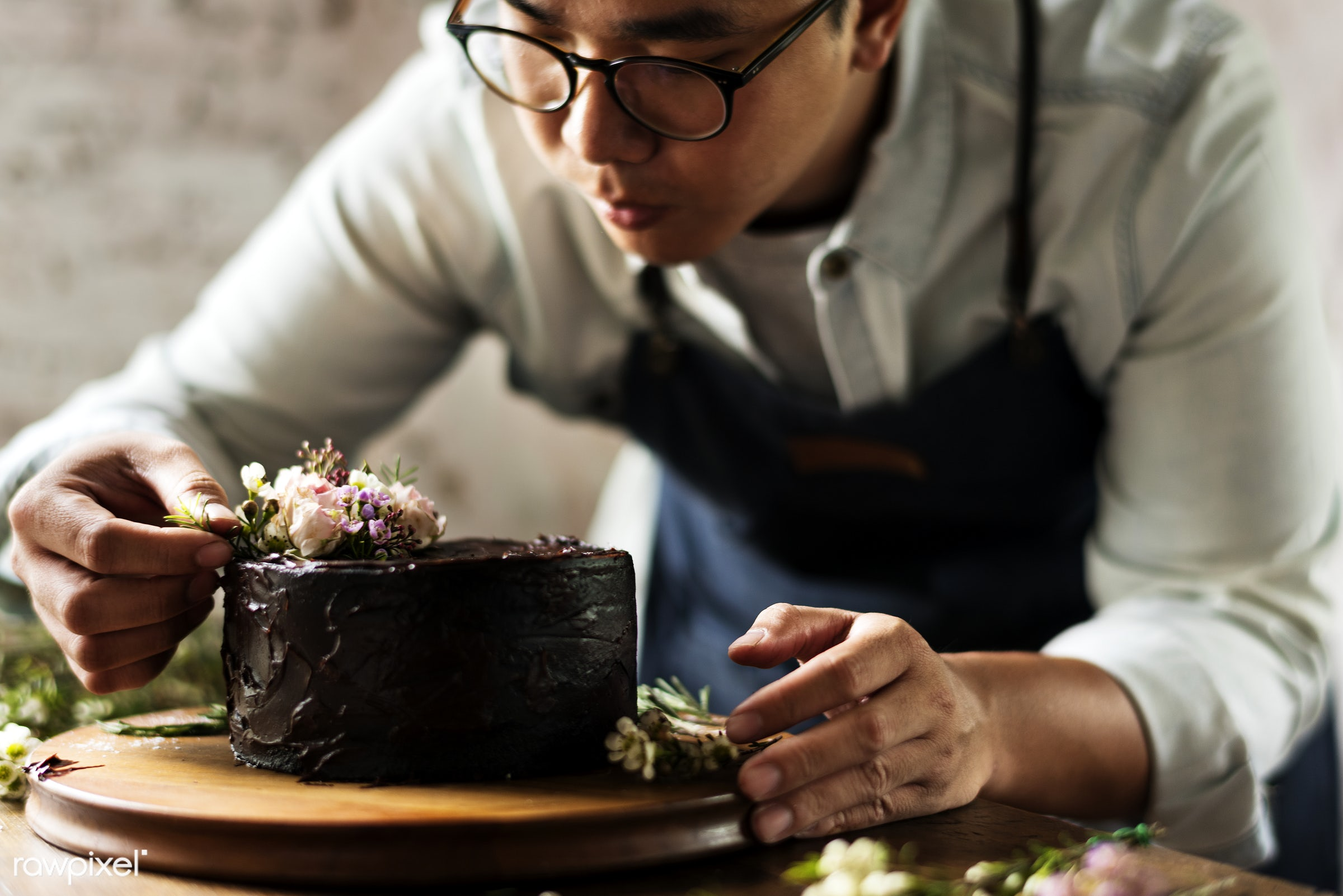 Baker Man Decorating Chocolate Cake with Flowers - art, bakery, cake, chocolate, decoration, dessert, floral, flowers, food...