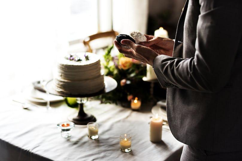 Hands looking at wedding cupcakes
