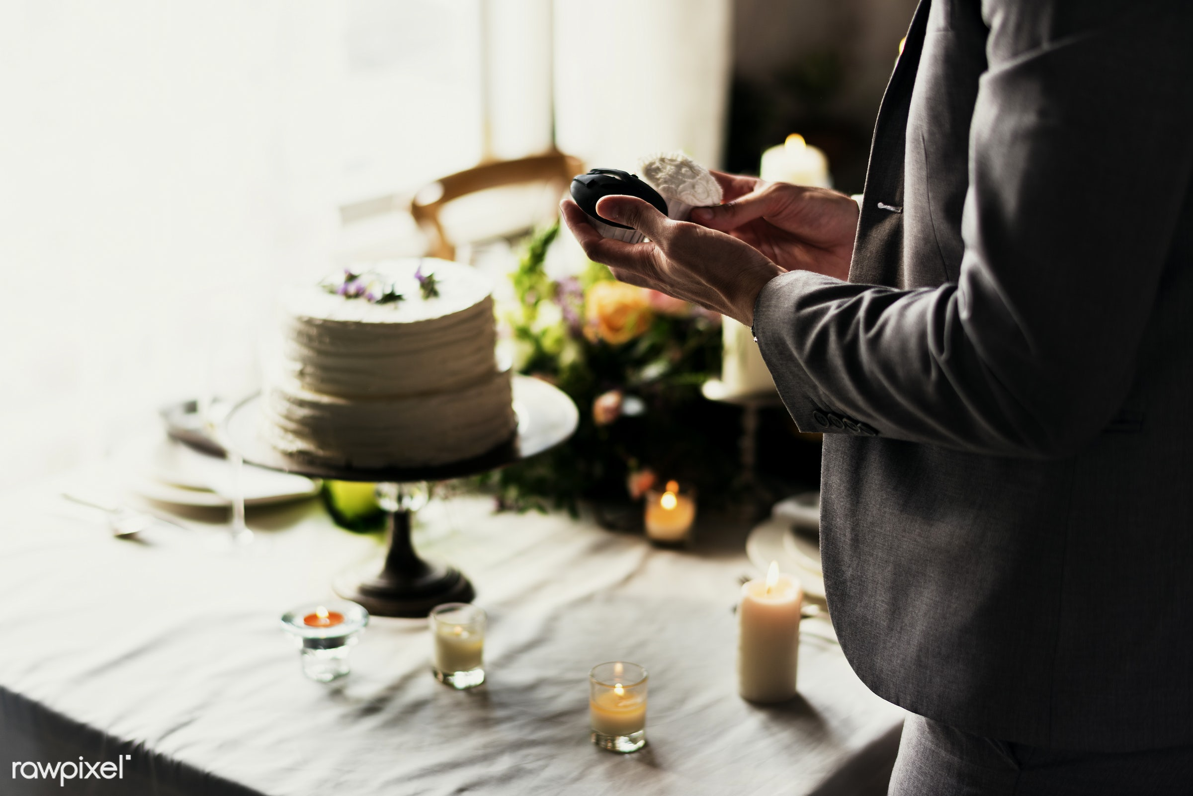 dish, person, holding, restaurant, party, people, candle, organization, hands, seat, event, men, man, flower, dessert, cake...