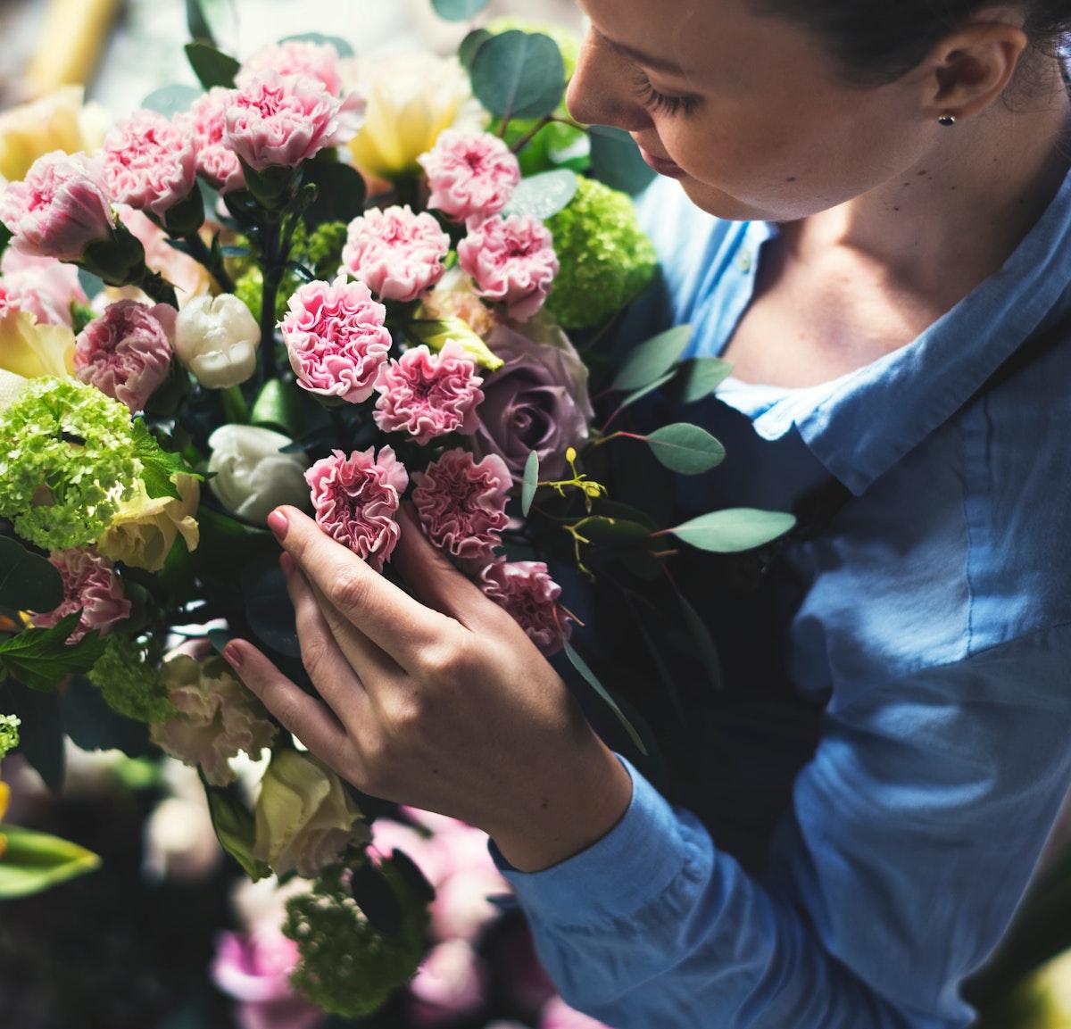 Florist Making Fresh Flowers Bouquet Arrangement