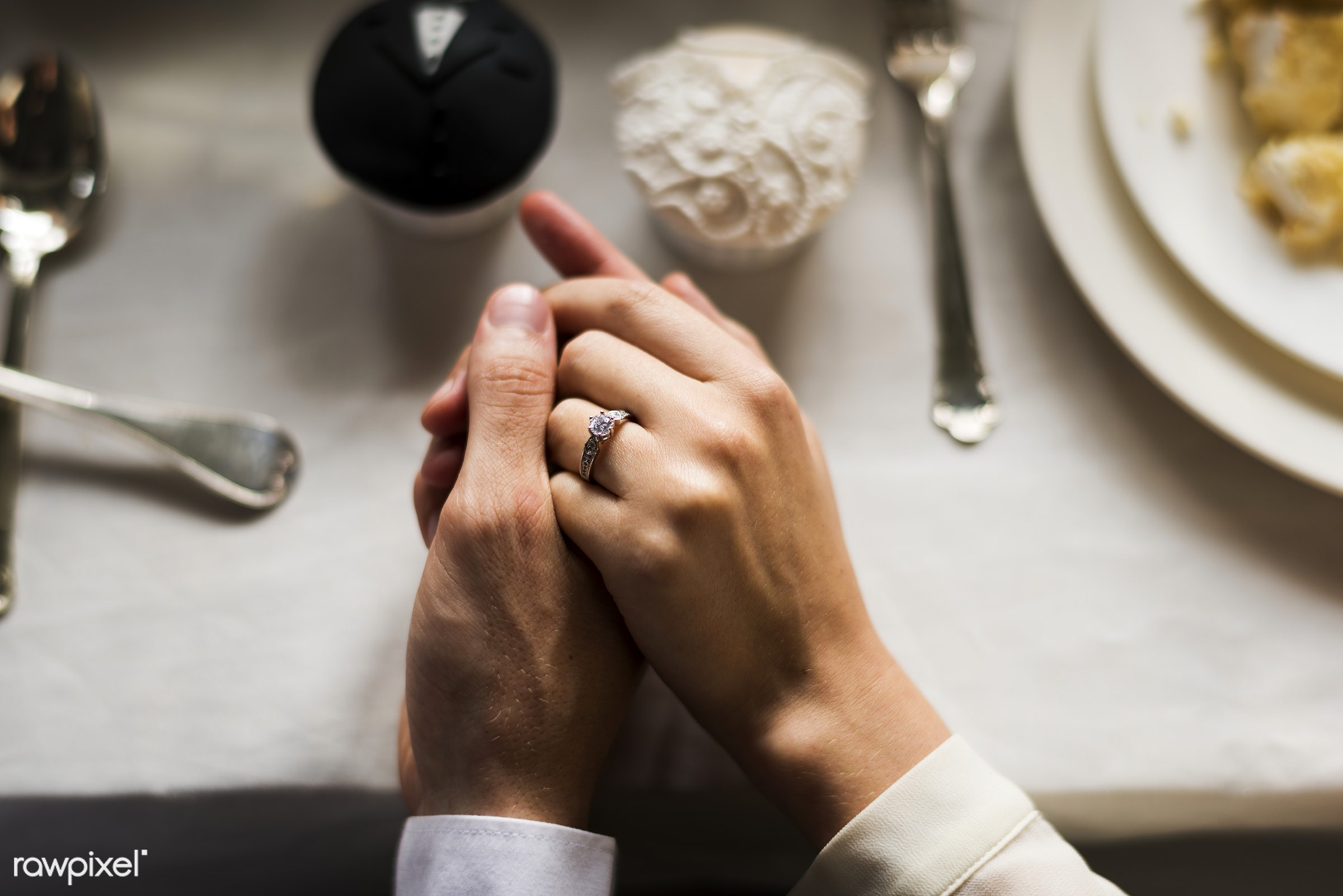 Close up of wedding couple hands holding each other - bride, celebration, closeness, closeup, couple, cupcake, event, groom...