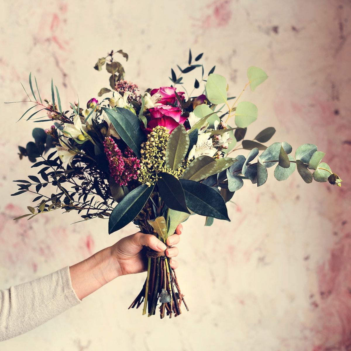 Woman Hands Holding Beautiful Flowers Bouquet