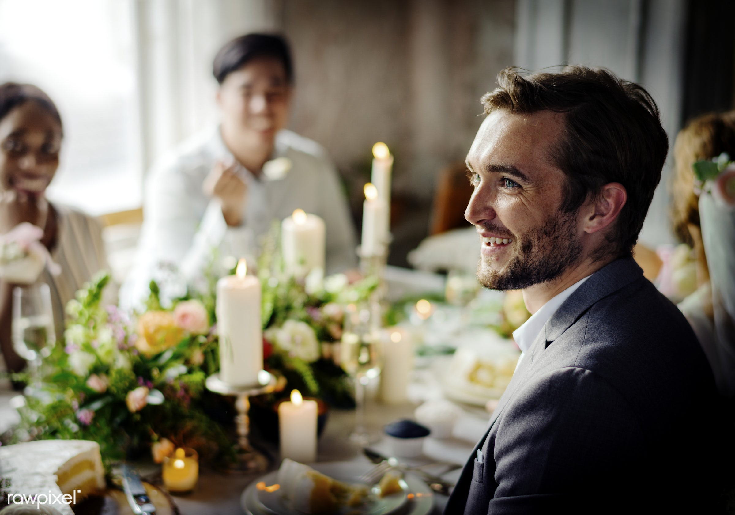 Groom listening to a speech at a wedding reception table - alcohol, bride, celebration, champagne, couple, drinking, event,...