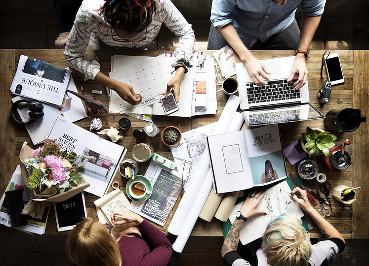 Colleagues working at a desk