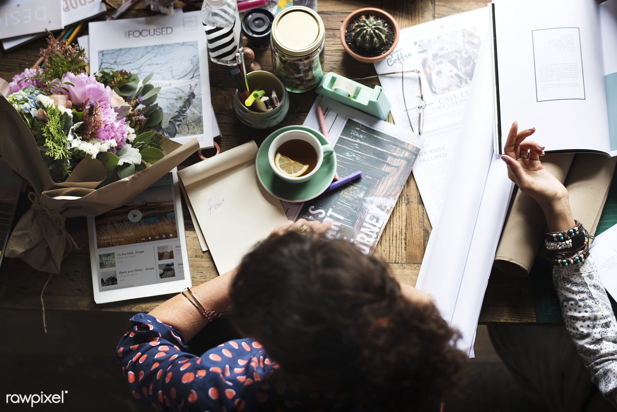 Aerial view of a woman at her desk - attach, attached, beverage, boquet, cactus, caucasian, coffee, concentration, create,...