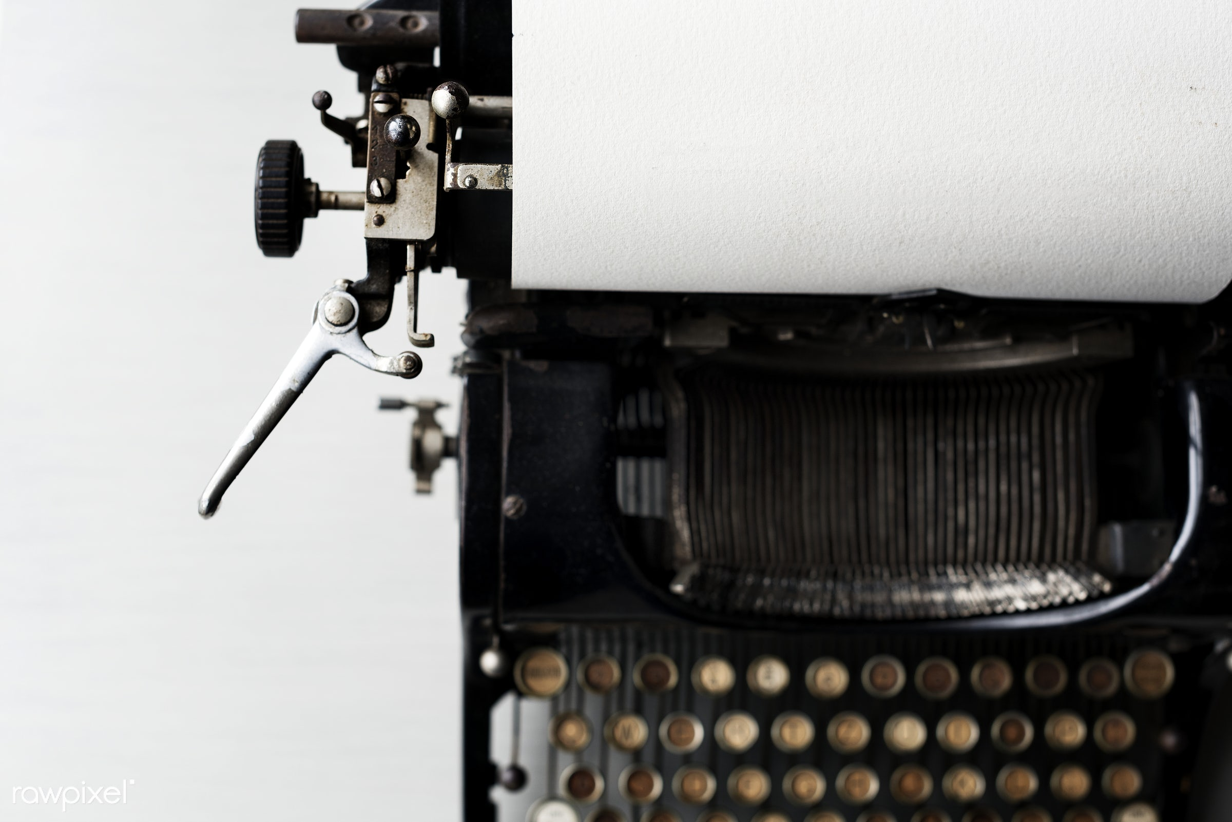 Old typewriter on white tabletop  - aerial view, antique, attach, attached, classic, closeup, equipment, flat lay, flatlay,...