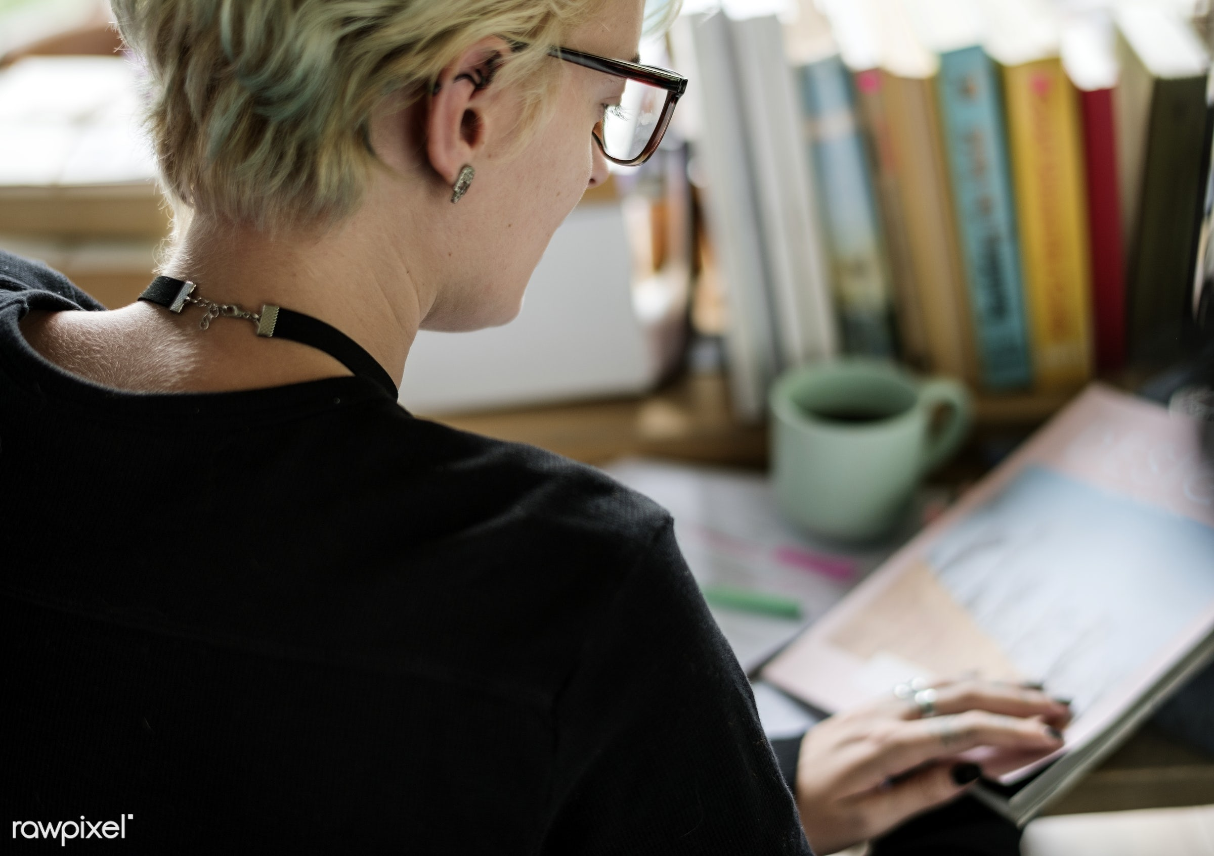 Blonde woman working in her office - reading, attach, book, attached, back, bookworm, closeup, desk, hobby, job, learning,...