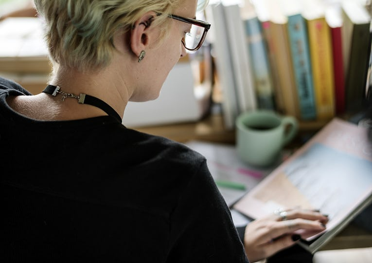 Blonde woman working in her office