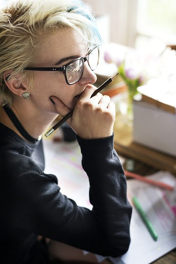 Blonde woman contemplating at her desk