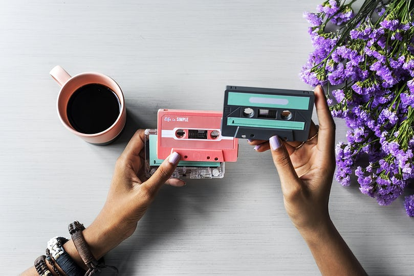 Hands Hold Showing Retro Music Audio Cassette Tape 80s