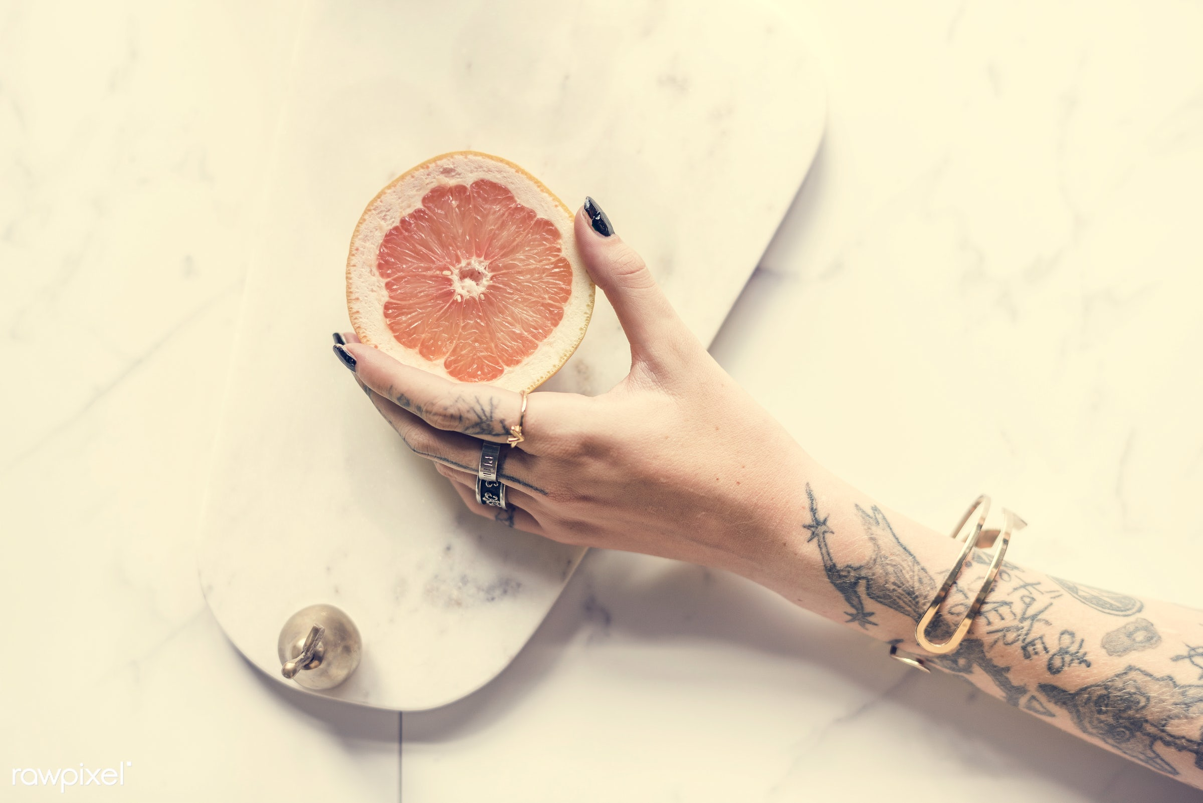 grab, getting, marble, person, relax, people, hand, life, style, woman, grabbing, lifestyle, tattoo, passion, orange, held,...