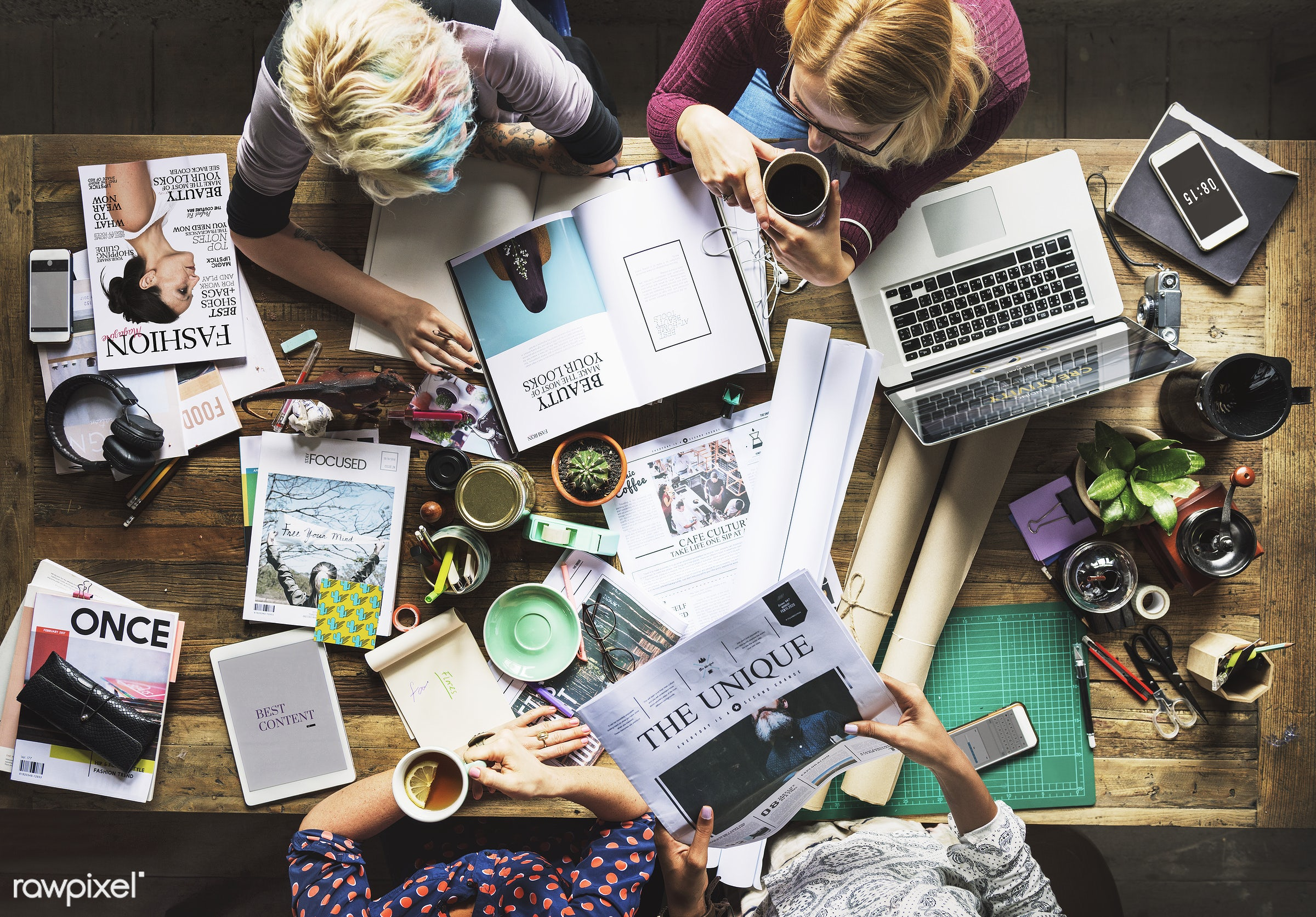 Colleagues working at a desk  - aerial view, attach, attached, business, colleagues, designers, desk, editors, group, job,...