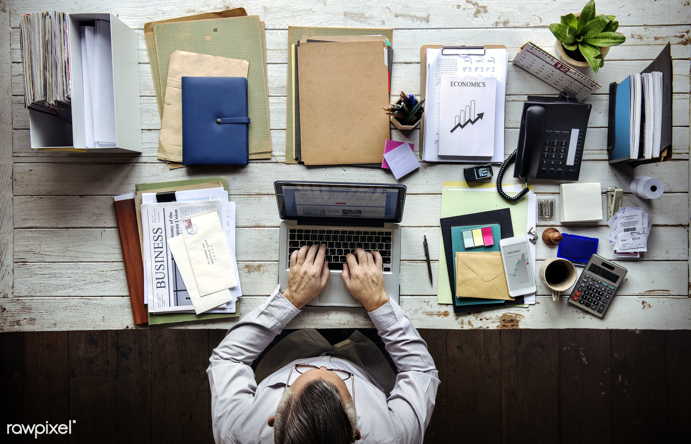 Man working on a laptop at his desk - action, adult, attach, business, businessman, busy, casual, folders, formal, ideas,...