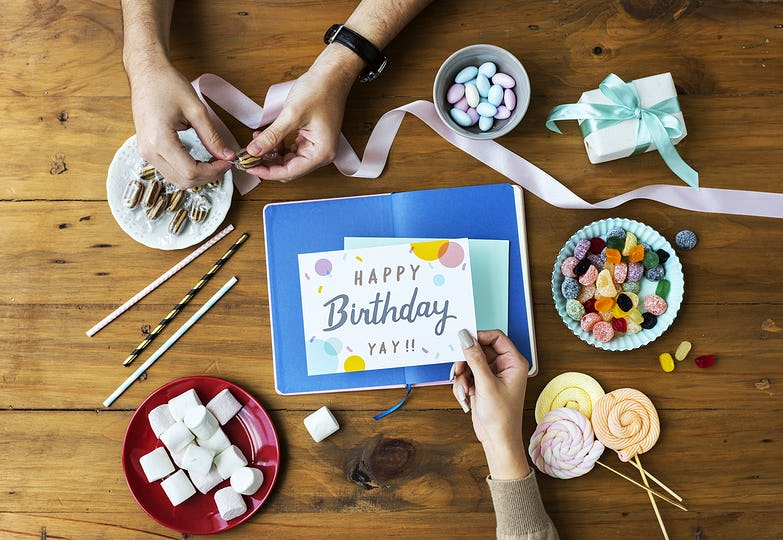Birthday Wish Card on Wooden Table Background with Sweet Snacks