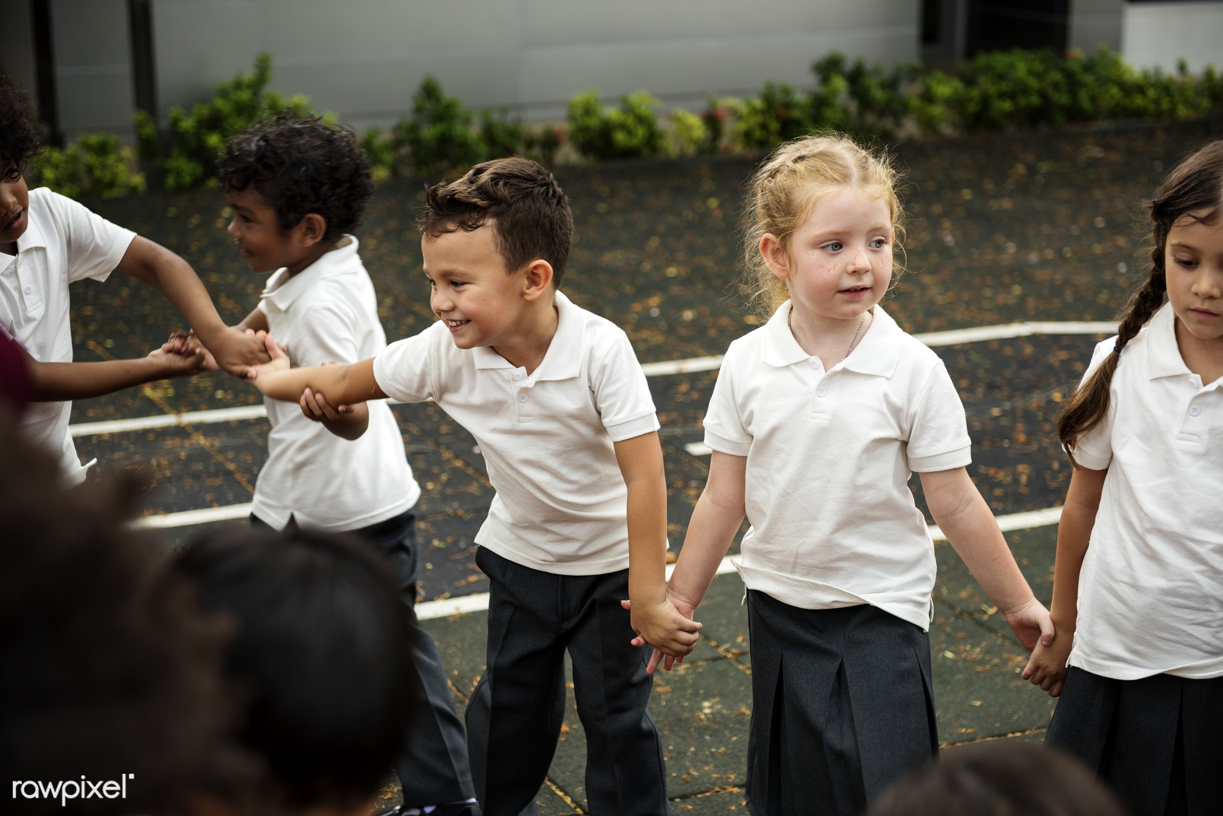 Happy kids at elementary school - playful, holding, children, together, friends, hands, boys, gathering, friendship,...