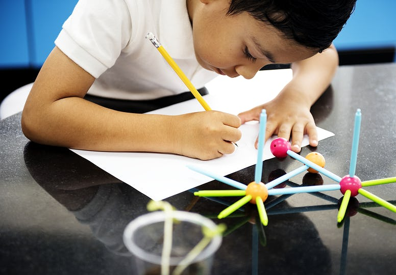 Boy doing schoolwork in science lab
